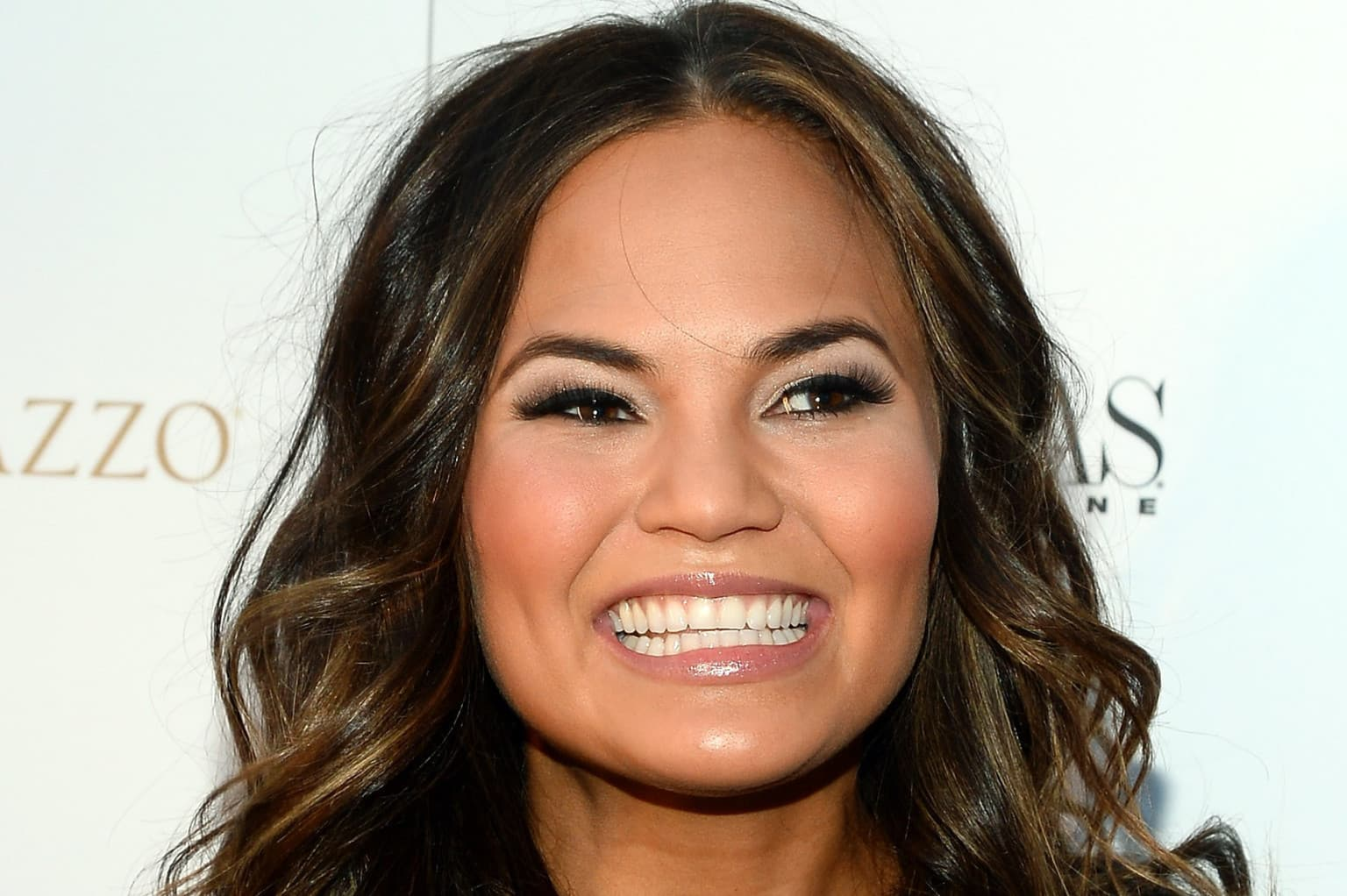 Chrissy Teigen Before After Plastic Surgery photo - 1